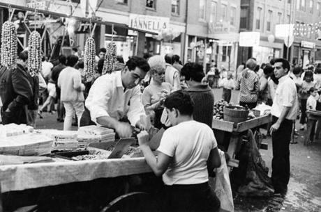 Boston, MA - 8/11/1967: A vendor sells a boy peanuts at the Hanover Street Market in Boston's North End on Aug. 11, 1967. () --- BGPA Reference: 141027_CB_006