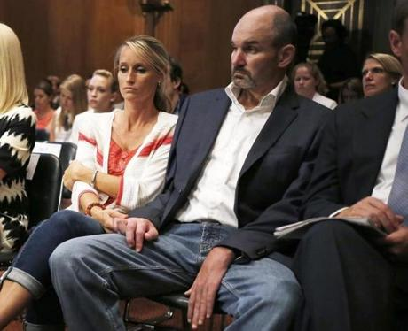 Allison Sanford Turner and Kevin Turner listened to testimony at a Senate Special Committee on Aging hearing in June 2014 regarding concussions and the long-term effects of brain-related sports injuries.