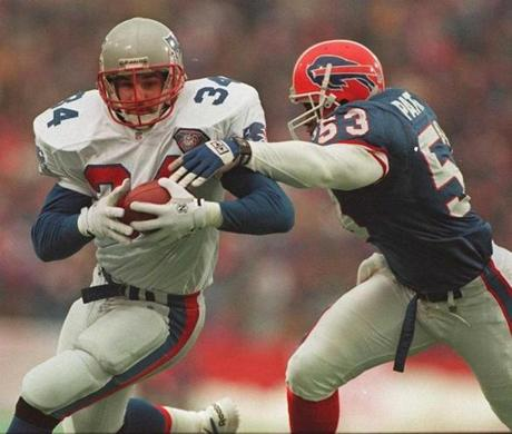 Kevin Turner (left) in his days as a hard-hitting Patriots fullback.