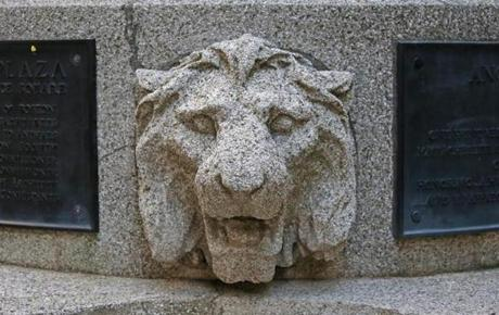 One of several lions in the Angell Memorial Park at Post Office Square, built in honor of the first president of the Massachusetts Society for the Prevention of Cruelty to Animals, George T. Angell.