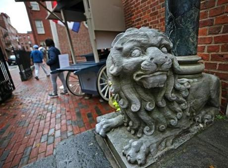 A statue by the steps of the gift shop at Old North Church in the North End.