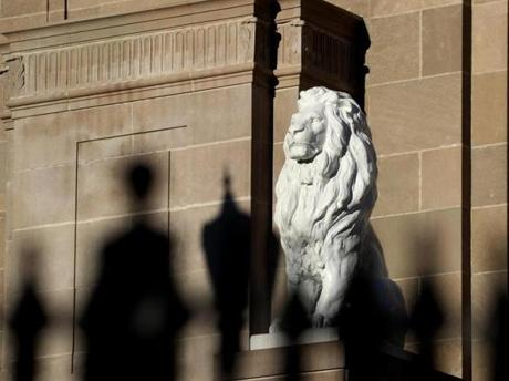 Framed by a steel fence, this lion is on the facade of the United House of Prayer for All People on Seaver Street, Dorchester. The building was once a Jewish temple, Congregation Mishkan Tefila.