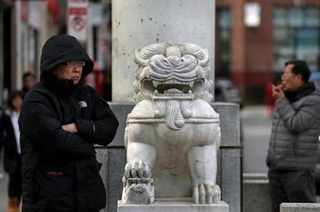 One of the marble Chinese Imperial Guardian lion sculptures at the Chinatown Gate in Boston, a gift from the Taiwanese government.
