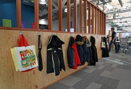 CAMBRIDGE, MA - 1/07/2019:A coat rack like somthing you would see at a schoolhouse in Facebooks new Cambridge site. Facebook preparing to open a large office in Kendall Square with space for hundreds of additional workers. (David L Ryan/Globe Staff ) SECTION: BUSINESS TOPIC 09facebook