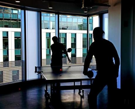 CAMBRIDGE, MA - 1/07/2019: Employees take a break playing table tennis at Facebooks Cambridge site. Facebook preparing to open a large office in Kendall Square with space for hundreds of additional workers. (David L Ryan/Globe Staff ) SECTION: BUSINESS TOPIC 09facebook