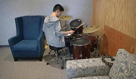 CAMBRIDGE, MA - 1/07/2019:In the music room, Gary Chen, software engineer plays the drums takes a workbreak. Facebook preparing to open a large office in Kendall Square with space for hundreds of additional workers. (David L Ryan/Globe Staff ) SECTION: BUSINESS TOPIC 09facebook
