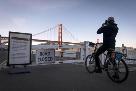 A cyclist took a photograph next to a sign announcing a national park closure due to a government shutdown.
