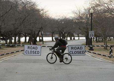 A biker turned around at a vehicle and pedestrian road block of the road leading to Hains Point at East Potomac Park.
