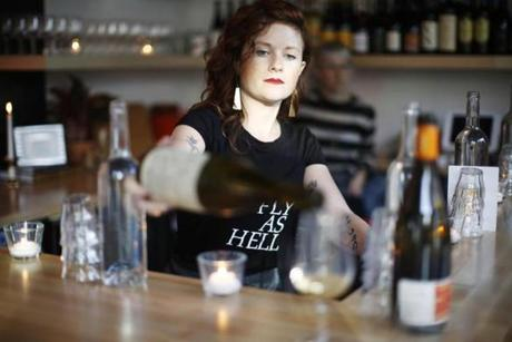 Somerville, MA - 10/17/2018- ]Lauren Friel, owner of Rebel Rebel pours a glass of wine at the bar on Wednesday, October 17, 2018. (Michael Swensen for The Boston Globe) Topic: (Metro)