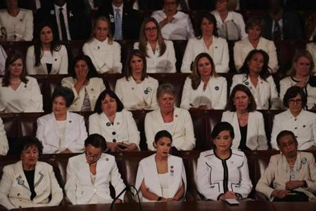 WASHINGTON, DC - FEBRUARY 05: Female lawmakers dressed in white watch as President Donald Trump delivers the State of the Union address in the chamber of the U.S. House of Representatives at the U.S. Capitol Building on February 5, 2019 in Washington, DC. A group of female Democratic lawmakers chose to wear white to the speech in solidarity with women and a nod to the suffragette movement. (Photo by Alex Wong/Getty Images)