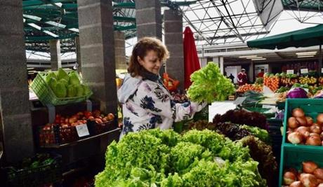 Guida Ponte, who leads food tours on the Azores inspects the produce at the farmers' market in Ponta Delgada on the island of São Miguel in the Azores