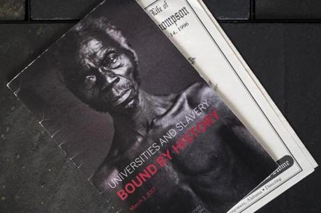 A 2017 program conference using as cover art an 1850 daguerreotype of the slave Renty, part of a Harvard professor's study arguing that black people were an inferior race, Feb. 28, 2019. Tamara Lanier is suing Harvard University for ownership of daguerreotypes of slaves, whom she counts as ancestors. (Karsten Moran/The New York Times)