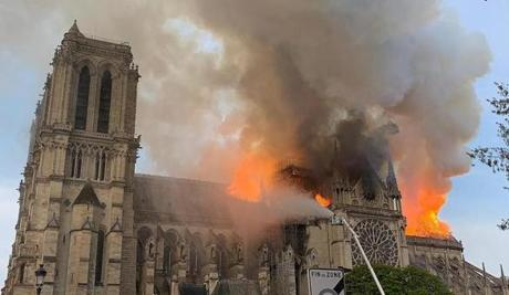 Flames and smoke are seen billowing from the roof at Notre Dame Cathedral in Paris on April 15, 2019. - A fire broke out at the landmark Notre Dame Cathedral in central Paris, potentially involving renovation works being carried out at the site, the fire service said.Images posted on social media showed flames and huge clouds of smoke billowing above the roof of the gothic cathedral, the most visited historic monument in Europe. (Photo by Patrick ANIDJAR / AFP) (Photo credit should read PATRICK ANIDJAR/AFP/Getty Images) *** BESTPIX ***