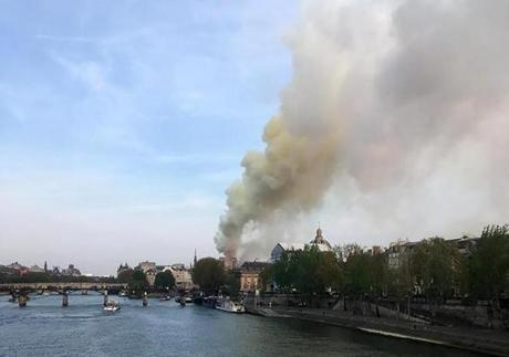 Flames and smoke are seen billowing from the roof at Notre Dame Cathedral in Paris on April 15, 2019. - A fire broke out at the landmark Notre Dame Cathedral in central Paris, potentially involving renovation works being carried out at the site, the fire service said.Images posted on social media showed flames and huge clouds of smoke billowing above the roof of the gothic cathedral, the most visited historic monument in Europe. (Photo by Pierre Galey / AFP)PIERRE GALEY/AFP/Getty Images