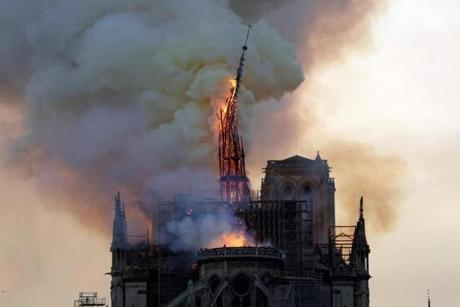 The steeple of the landmark Notre Dame Cathedral collapses as the cathedral is engulfed in flames in central Paris on April 15, 2019. - A huge fire swept through the roof of the famed Notre Dame Cathedral in central Paris on April 15, 2019, sending flames and huge clouds of grey smoke billowing into the sky. The flames and smoke plumed from the spire and roof of the gothic cathedral, visited by millions of people a year. A spokesman for the cathedral told AFP that the wooden structure supporting the roof was being gutted by the blaze. (Photo by Geoffroy VAN DER HASSELT / AFP)GEOFFROY VAN DER HASSELT/AFP/Getty Images