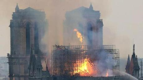 Smoke and flames rise during a fire at the landmark Notre Dame Cathedral in central Paris on April 15, 2019, potentially involving renovation works being carried out at the site, the fire service said. - A major fire broke out at the landmark Notre Dame Cathedral in central Paris sending flames and huge clouds of grey smoke billowing into the sky, the fire service said. The flames and smoke plumed from the spire and roof of the gothic cathedral, visited by millions of people a year, where renovations are currently underway. (Photo by LUDOVIC MARIN / AFP)LUDOVIC MARIN/AFP/Getty Images