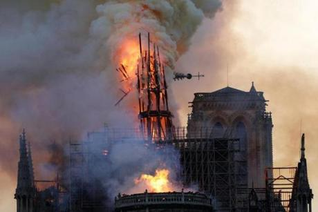 The steeple collapses as smoke and flames engulf the Notre Dame Cathedral in Paris on April 15, 2019. - A huge fire swept through the roof of the famed Notre Dame Cathedral in central Paris on April 15, 2019, sending flames and huge clouds of grey smoke billowing into the sky. The flames and smoke plumed from the spire and roof of the gothic cathedral, visited by millions of people a year. A spokesman for the cathedral told AFP that the wooden structure supporting the roof was being gutted by the blaze. (Photo by Geoffroy VAN DER HASSELT / AFP)GEOFFROY VAN DER HASSELT/AFP/Getty Images