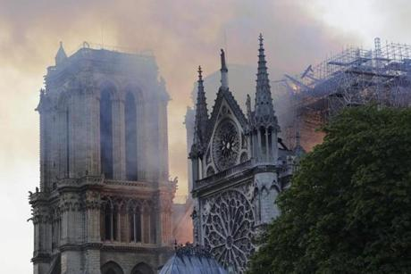 Flames and smoke are seen billowing from the roof at Notre Dame Cathedral in Paris on April 15, 2019. - A fire broke out at the landmark Notre Dame Cathedral in central Paris, potentially involving renovation works being carried out at the site, the fire service said. (Photo by Thomas SAMSON / AFP)THOMAS SAMSON/AFP/Getty Images