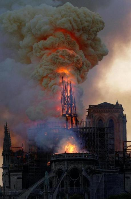 The steeple engulfed in flames collapses as the roof of the Notre Dame de Paris Cathedral burns on April 15, 2019 in Paris. - A colossal fire swept through the famed Notre Dame Cathedral in central Paris on April 15, 2019, causing a spire to collapse and raising fears over the future of the nearly millenium old building and its precious artworks. The fire, which began in the early evening, sent flames and huge clouds of grey smoke billowing into the Paris sky as stunned Parisians and tourists watched on in sheer horror. (Photo by Geoffroy VAN DER HASSELT / AFP)GEOFFROY VAN DER HASSELT/AFP/Getty Images