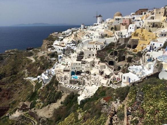 The sunsets in Santorini are renowned, with crowds gathering every night to watch. After the sun faded this night in the town of Oia, the hundreds of people applauded.
