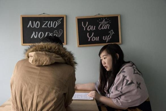 For a story by Jessica Meyers, 16china Beijing, December 19th 2015 At the offices of Nuts, an agency helping Chinese students in their application for American Universities, Chenya Sun (left) a consultant is evaluating the needs of Wanyi Zheng (back) a student in mathematics at Tsinghua University, who has come to Nuts, seeking their help in her applications for Ph.D programmes at american universities. (Gilles Sabrie for The Boston Globe)