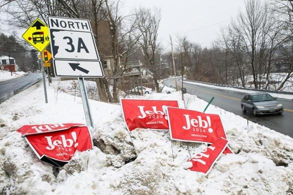 Campaign signs still lined the road in Hooksett, N.H., the day after the first-in-the-nation primary.