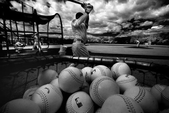 Fort Myers- Feb 28, 2016- globe photo by Stan Grossfeld- For Globe Magazine only- Red Sox jack of all trades Brock Holt loosens up before taking live batting practice at Fenway South. (Shot in infrared)