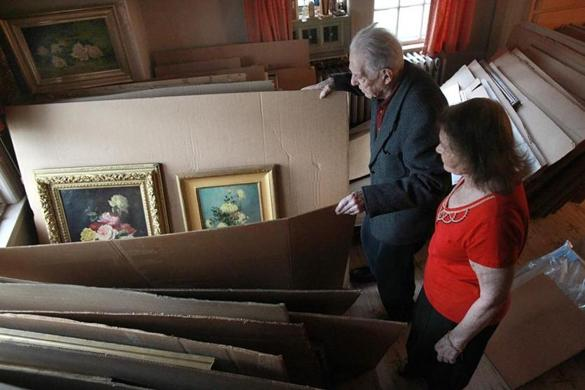 Sam and Sheila Robbins, in one of their home's spare bedrooms where many of their paintings are stored, are the biggest art collectors no one's ever heard of.