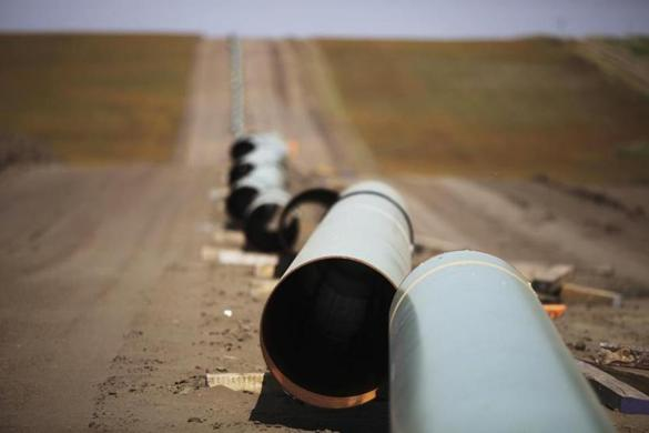 FILE -- A gas pipeline under construction in Belfield, N.D., Sept. 3, 2011. In another example of how record-low oil and natural gas prices are causing severe pain radiating from the Texas Panhandle to Wall Street, shares of Energy Transfer Equity and the Williams Companies have plummeted, partly because of numerous concerns about their complicated merger. (Jim Wilson/The New York Times)