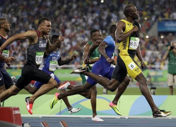 Jamaica's Usain Bolt celebrated as he crosses the line to win gold in the men's 100-meter final.