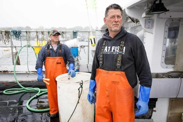 Gloucester lobstermen Ira Shank (left) and Larry Hudson took off their rubber coveralls, which they wear to try to keep dry and somewhat clean.