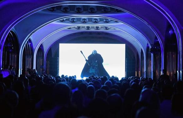 "A crowd watches an episode of the current season of ""Game of Thrones"" at a metro station in Moscow."