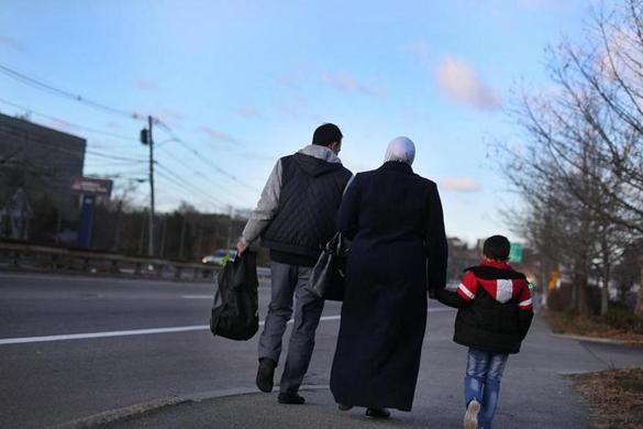 Abu Alnoor and his wife, Um Alnoor, walked their 5-year-old son, Alnoor, along Route 9 in Framingham to his bus stop.