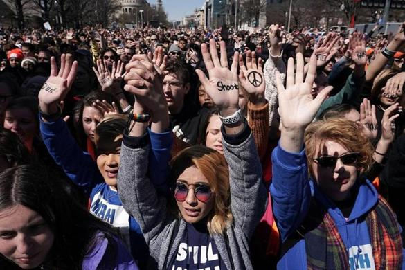Protesters, including Daisy Hernandez of Virginia (third left) and Hunter Nguyen of Maryland (second left), held their hands up in Washington, D.C.