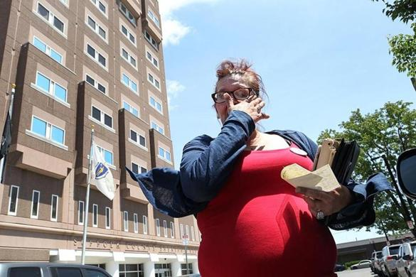 Boston, Ma., 06/12/18, Dawn Dingee is the mother of Stephen Gonzalez, who died of an overdose in April a few hours after being released from jail. Stephen had been on methadone but was forced off it in jail. Dawn went to the Suffolk County House of Correction to pick up her son's belongings, but all she received was this check for $82.71 and was told his things were disposed of because it had been past 30 days. Suzanne Kreiter/Globe staff