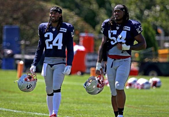 Foxborough, MA - 8/02/2018 - New England Patriots defensive back Stephon Gilmore (24) and New England Patriots linebacker Dont'a Hightower (54) at New England Patriots training camp practice at Gillette Stadium in Foxborough. - (Barry Chin/Globe Staff), Section: Sports, Reporter: Ben Volin, Topic: 03Patriots, LOID: 8.4.2729533288.