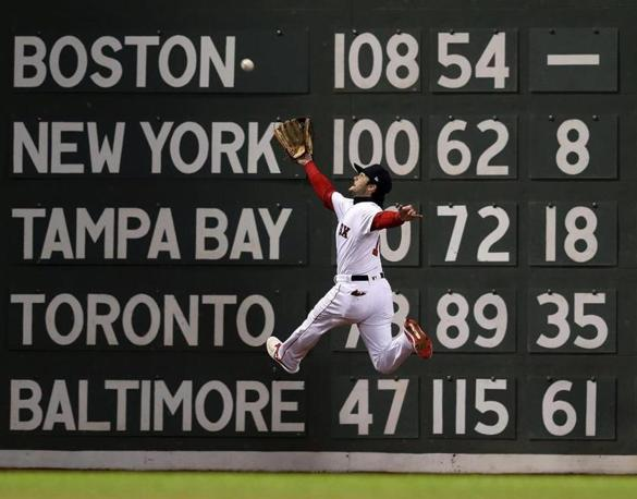 Red Sox left fielder Andrew Benintendi leaps and makes the catch to rob the Dodgers Brian Dozier of a hit in the top of the fifth inning.