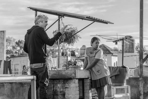 "Director Alfonso Cuaron and actress Yalitza Aparicio on the set of ""Roma."""