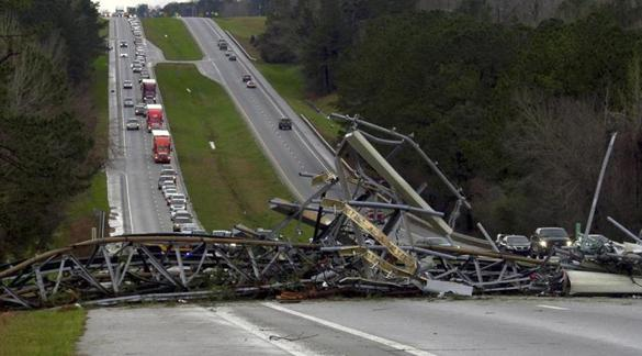 A fallen cell tower across US Route 280 highway in Lee County, Ala., after what appeared to be a tornado struck in the area Sunday.