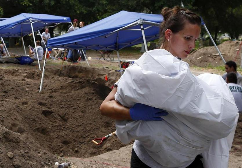 Ashley Roy, who works for the Waco Police Department, helped members of the Baylor team to exhume bodies.
