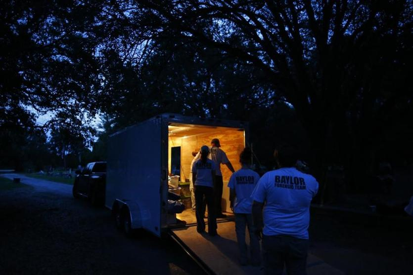 Members of the Baylor team unloaded equipment from their trailer before sunrise.
