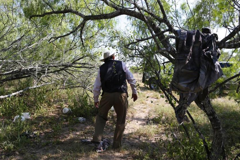 Rancher Lavoyger Durham walked past clothing left behind by immigrants. Last year, Durham was rounding up cattle when he found a body on his ranch.
