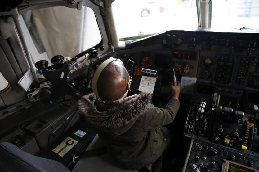 Spokane, Washington -- 2/14/2015-- Leo, 4, sat in the captain's seat after his flight landed in Spokane, Washington February 12, 2015. Jessica Rinaldi/Globe Staff Topic: 042615burn Reporter:
