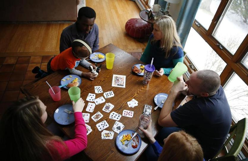 West Yarmouth, Massachusetts -- 2/5/2015-- Alex and Leo share a meal with the Criser's at their home in West Yarmouth, Massachusetts February 7, 2015. The Criser's are one of a network of families who have given Alex and Leo a place to stay while they're in the US getting treatment at Shriners for Leo's burns. Jessica Rinaldi/Globe Staff Topic: 042615burn Reporter: