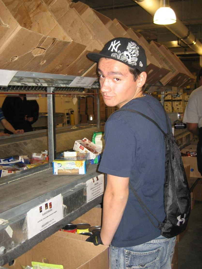 Marco at 15, volunteering for The Greater Boston Food Bank. He was suffering from panic attacks at this point, but said nothing about his problems to his friends or family.