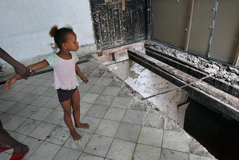 Matanzas, Cuba, 06/015/15, Erianni Diaz, 4, and her grandmother, Maria Garcia, live in a condemned hotel. Erianni has twice fallen through a hole in the floor of her second floor rooms. She has sustained brain and optic nerve damage. The hotel is less than half a block from the goverment office that handles citizen complaints. Suzanne Kreiter/The Boston Globe