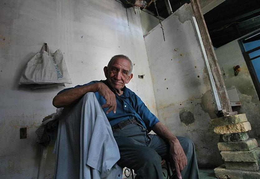 Matanzas, Cuba, 06/015/15, Raoul Zapata Bajo, 77, in photo, and his brother Miguel, 75, who has Alzheimers Disease, live in the house with a collapsed ceiling, whichis being held up by uneven bricks and a temporary pole. Suzanne Kreiter/The Boston Globe