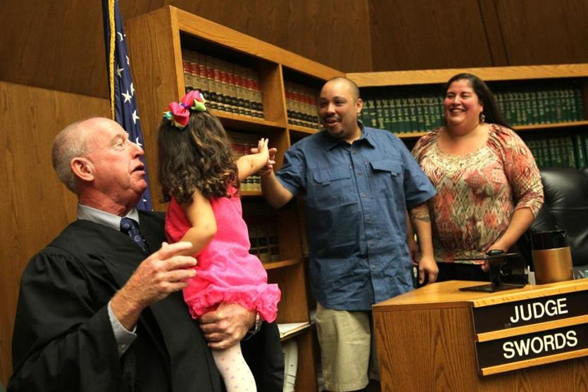 First Justice Daniel Swords held a celebratory Alexandra after awarding permanent custody to Treehouse community residents Angel and Sandra Rubio in Hampden Juvenile Court in Springfield in September.