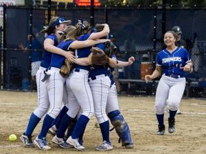 8.3.2827582534_Sports_18hssoftball Turners Falls players rush to the mound to celebrate their 2-1victory over Austin Prep during the Div. 3 State Softball Final in Worcester State College in Worcester, Mass., Saturday, June 17, 2017. (Robert E. Klein for the Boston Globe)