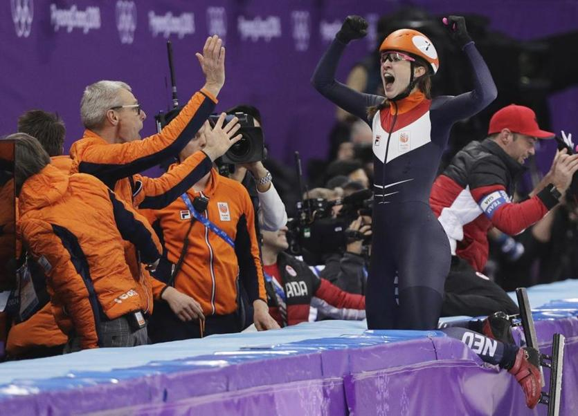 Suzanne Schulting of the Netherlands celebrates after winning the women's 1000 meters short track speedskating A final in the Gangneung Ice Arena at the 2018 Winter Olympics in Gangneung, South Korea, Thursday, Feb. 22, 2018. (AP Photo/David J. Phillip)